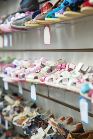 Counter with baby shoes at fashionable shop