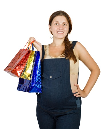 8 months pregnancy: pregnant woman with shopping bags.