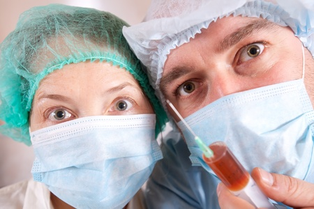anesthetize: close up shot of two doctors with syringe