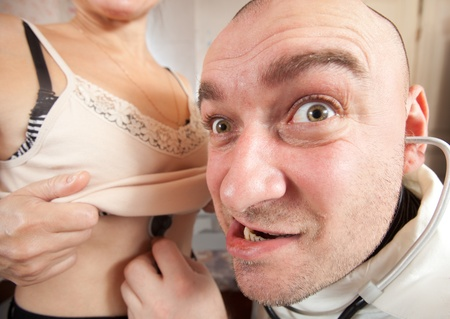 auscultoscope: Wide angle shot of doctor listening  the  patient with  stethoscope in clinic