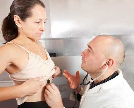 touch down: Doctor listening  the patient with  stethoscope in clinic