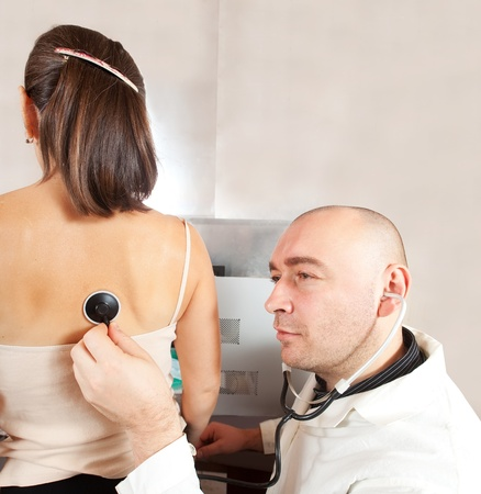 Male doctor examining the patient in clinic Stock Photo - 11208396