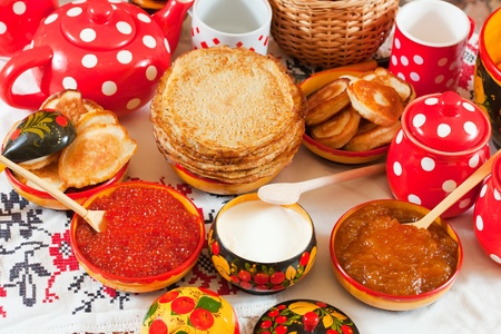 maslenitsa: Maslenitsa festival meal - pancake with caviar and tea Stock Photo