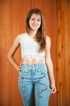 stitchcraft: Teen girl shows a handmade jeans beaded by herself Stock Photo