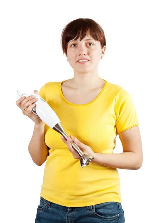 ove: Woman with electric hand blender. Isolated ove white background   Stock Photo