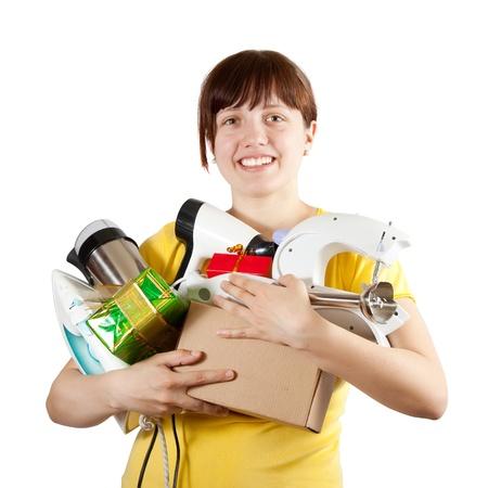 mujer joven en amarillo con electrodom�sticos y regalos photo