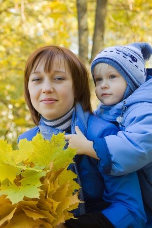 Woman with  little boy in autumn park photo