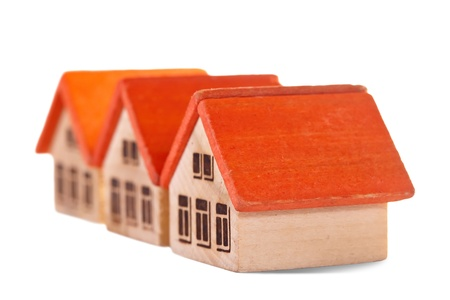 Row of wooden  toy house on white background Stock Photo - 11471554