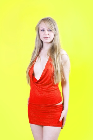 sexy girl in red dress over yellow background photo
