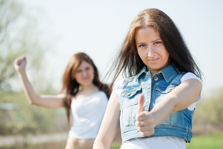 Two happy women with thumb up  Stock Photo - 11480071