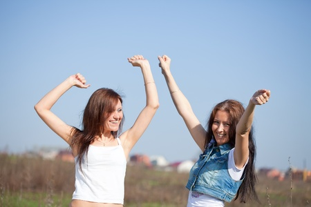 Two happy women together against sky Stock Photo - 11479475