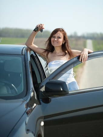 Mid adult woman holding keys to new car Stock Photo - 11479486