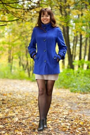 Outdoor portrait of happy woman in autumn photo
