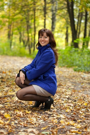Outdoor portrait of young brunette woman Stock Photo - 11480003