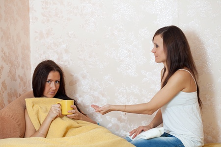 woman cares for a sick friend in home photo