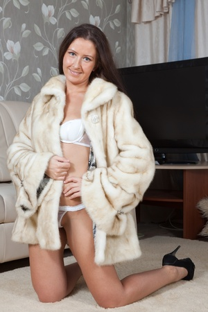 Sexy woman in fur coat  at home inter Stock Photo - 11479958