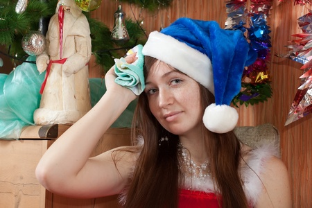 Woman in christmas hat having hangover at home photo