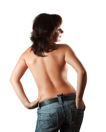 Rear view of topless  girl in jeans. Isolated over white Stock Photo - 11479856