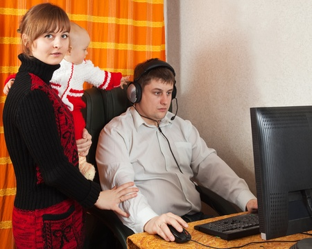 mother and daughter disturbs  father works at home photo