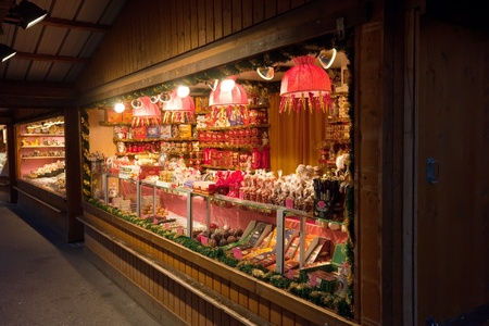 VIENNA, AUSTRIA  - NOVEMBER 22: Store  at Christmas Markets near old city hall in Austria. The Vienna Christmas Market on November 22, 2011 in Vienna, Austria. Kiosk with candy at Christmas market in Vienna