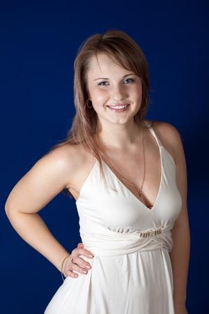 glamur: Portrait of smiling girl over blue background