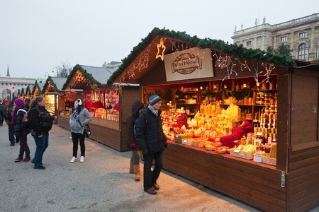 VIENNA, AUSTRIA - NOVEMBER 22: People walking at  Christmas Market at Maria-Theresien-Platz   in November 22, 2011 in Vienna, Austria.  This market is focused on authentic handicrafts made by local artists