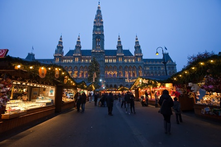 VIENNA, AUSTRIA - NOVEMBER 22: People  walking at  traditional Christmas market near old town hall  in November 22, 2011 in Vienna, Austria. This market is focused on authentic handicrafts made by local artists Stock Photo - 11400527