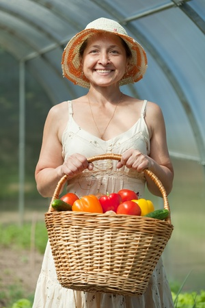 Happy mature woman with vegetables harvest photo