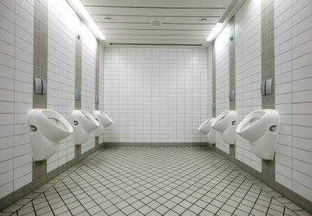 Few white urinals in toilet Stock Photo - 20408338