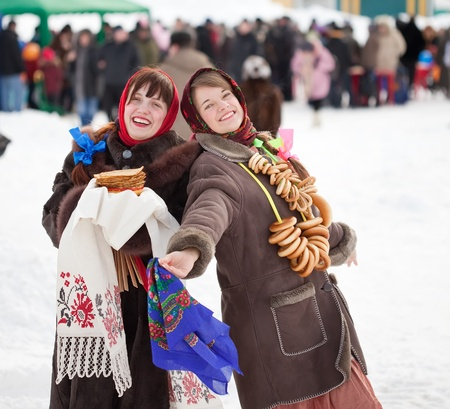 sudarium: Two happy girls celebrating  Pancake Week at Russia Stock Photo