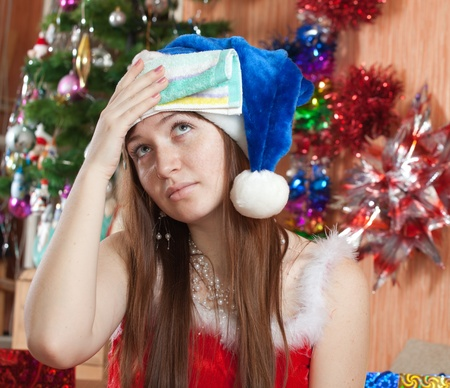 stupes: Woman in christmas hat having hangover at home