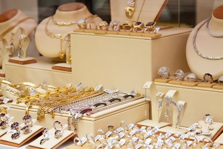 counter with variety jewelry in store window