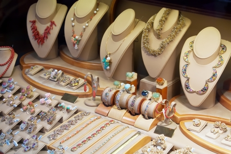 boutique shop: counter with a variety of jewelry in store window