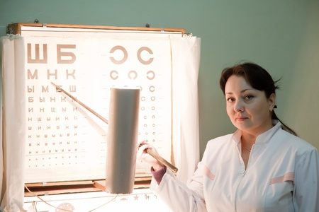 ophthalmologist testing  eyesight with letter table Stock Photo - 11636223