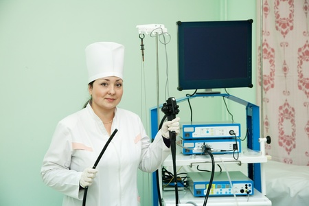 Doctor with endoscope ready for work in medical clinic photo
