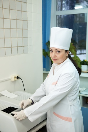 Doctor working with Biochemistry Analyzer in medical clinic Stock Photo - 11636232