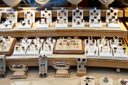 carbuncle: counter with garnet jewelry in store window Editorial