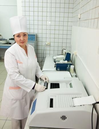 analyzer: Doctor working with Biochemistry Analyzer in medical clinic