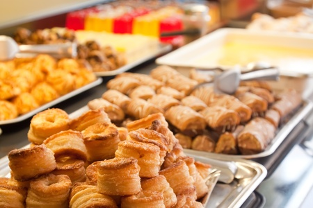 various  fresh pastry on table in buffet  Stock Photo