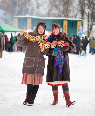 Two happy girls celebrating  Shrovetide  at Russia Stock Photo - 11636730
