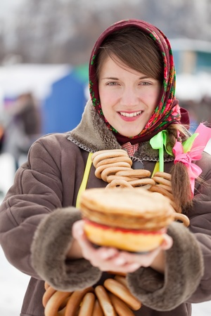 sudarium: Smiling girl with pancake  during  Shrovetide at Russia Stock Photo
