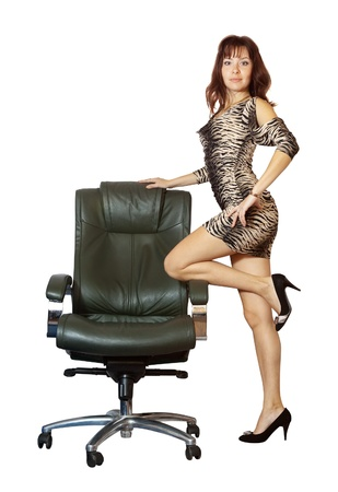 woman near on luxury office armchair, isolated over white background photo
