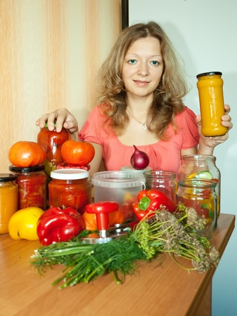 preserving: Woman making pickled vegetables in the kitchen