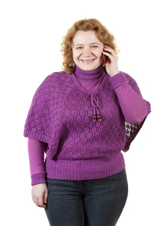 fat unsightly woman speaks by mobile. Isolated over white photo