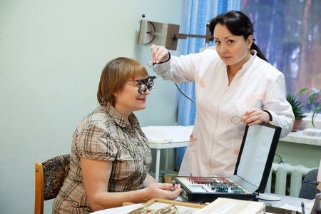 eyesight: ophthalmologist  and patient testing  eyesight  in clinic
