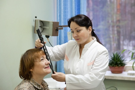 ophthalmologist  and patient testing  eyesight  in clinic photo