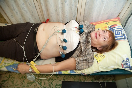 Female patient during ECG  procedure  in clinic photo