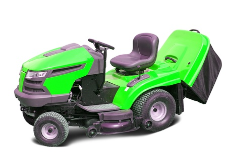 Green lawn mower. Isolated with clipping path photo