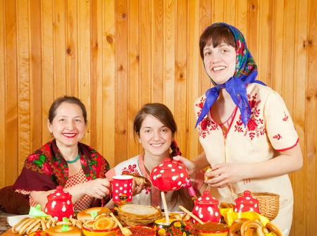 banket: Women drinks tea with pancake during  Shrovetide Stock Photo