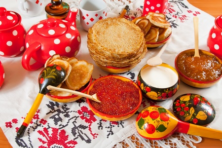 Pancake with red caviar and tea during  Shrovetide photo